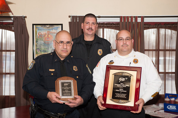 131211 Traffic Safety JOED VIERA/STAFF PHOTOGRAPHER Lockport, NY-Jose Avila of the Medina Police Department as well as Bill Scribner and Roland Nenni of the Albion Police Department accept the  American Automobile Association's 2013 Community Traffic Safety award on Wednesday Dec 11th, 2013.