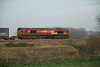 12 December 2013 :: A side view of 66127 with 4L45 from Wakefield Europort to Felixstowe departing Ely