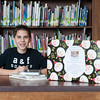 131205 Newfane Book Drive  JOED VIERA/STAFF PHOTOGRAPHER Newfane, NY-Newfane Middle School student Tyler Gmerek sits with a donation box for books benefiting a Sandy Hook  charity started by the school on Thursday Dec 5th, 2013.