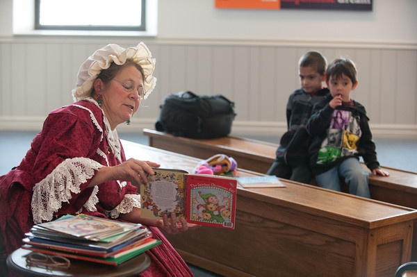 "131130 Santas Wife JOED VIERA/STAFF PHOTOGRAPHER Lockport, NY- Mason Troy(Right) and Aiden Owens(Left) listen to Mrs. Claus read ""The Littlest Christmas Elf"" at the Erie Canal Discovery Center on Saturday Nov 30th, 2013."