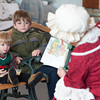 "131130 Santas Wife JOED VIERA/STAFF PHOTOGRAPHER Lockport, NY- Connor(right) and Max(left) Sherwood listen to Mrs. Claus read ""The Littlest Christmas Elf"" at the Erie Canal Discovery Center on Saturday Nov 30th, 2013."