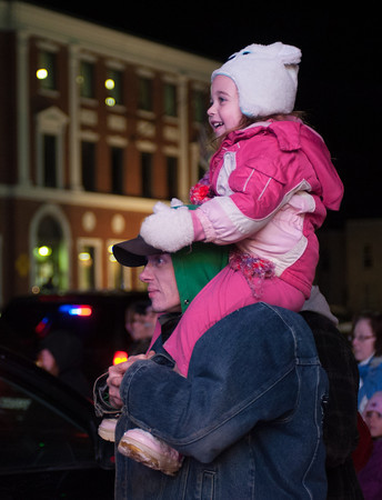 "131130 Parade JOED VIERA/STAFF PHOTOGRAPHER Lockport, NY-Alene Hagan(3) sits on top of her father Joe Hagen's shoulders watching floats go by at this years Christmas on the Canal ""Parade in the Dark"" on Saturday Nov 30th, 2013."