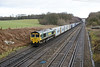 30 December 2013 :: The diverted 4L31 from Bristol to Felixstowe is seen heading away from Potbridge with 66541 at the rear of the consist