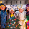 "131130 USJ Float JOED VIERA/STAFF PHOTOGRAPHER Lockport, NY- Cj Alicea, Mitchell Stutz, Hannah Green, and Haylee Green stand on the US&J float before this years Christmas on the canal ""Parade in the Dark"" on Saturday Nov 30th, 2013."