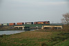 12 December 2013 :: In fading afternoon winter sunshine on the new bridge over the River Great Ouse at Ely is 66127 with 4L45 from Wakefield Europort to Felixstowe container train