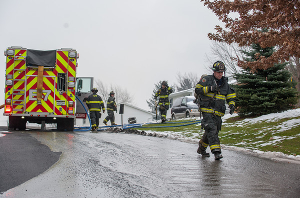131202 Firefight JOED VIERA/STAFF Lockport, NY- Lockport Firefighters work on putting out a fire that burned down the garage at 420 Michigan street  on Monday Dec 2nd, 2013.