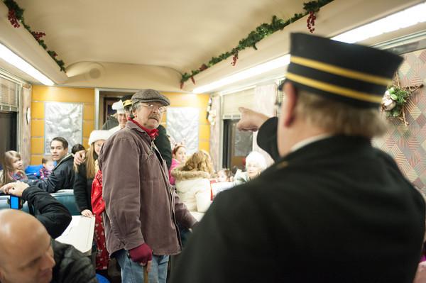 131208 Polar Express JOED VIERA/STAFF PHOTOGRAPHER Medina, NY-The Polar Express conductor kicks a hobo off of the train for lack of a ticket on Sunday Dec 8th, 2013.