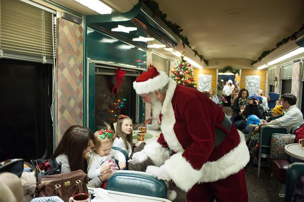 131208 Polar Express JOED VIERA/STAFF PHOTOGRAPHER Medina, NY-Santa Clauss gives a bell to a passenger on the Polar Express on the train back from the North Pole on Sunday Dec 8th, 2013.
