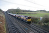 30 December 2013 :: Working empty coaching stock from Wembley to Eastleigh (5O61) are 66238 & 66232 and are seen passing Potbridge
