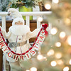 """131130 Gould Flowers JOED VIERA/STAFF PHOTOGRAPHER Lockport, NY- A Santa Claus figure holds up a """"Merry Christmas"""" sign at Gould Flower's on Locust st during their open house on Saturday Nov 30th, 2013."""
