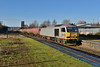 20 December 2013 :: In superb winter sunshine a very late running 6A11 from Robeston to Theale with loaded oil passes through Newbury Racecourse Station powered by Tata liveried 60099