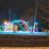 131211 Winter Wonderland JOED VIERA/STAFF PHOTOGRAPHER Lockport, NY-A large Christmas decoration of Santa Clauss lights up the view from across the canal on Lockport's Market Street  Wednesday Dec 11th, 2013.