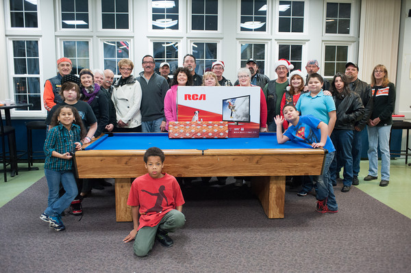 131202 Harley Christmas JOED VIERA/STAFF PHOTOGRAPHER Lockport, NY- Wyndham Lawn students and members of Niagara Falls Harley Owners Group stand with a 42 inch television gifted to the school by the group on Monday Dec 2nd, 2013.