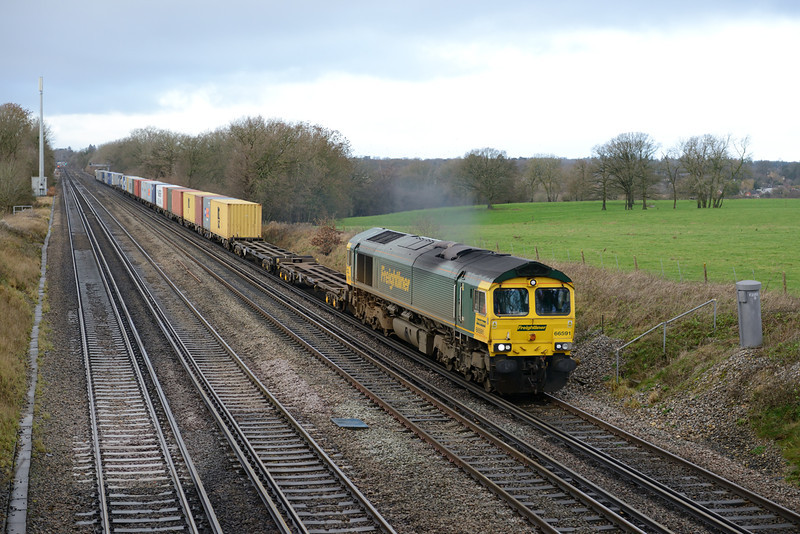 30 December 2013 :: These days its unusual to see a Freightliner east of Basingstoke on the SW Main Line. Because of the major infrastructure work at Reading, 4L31 from Bristol to Felixstowe was diverted via Westbury, Salisbury and Basingstoke and the train is seen passing Potbridge headed by 66591 with 66541 at the rear