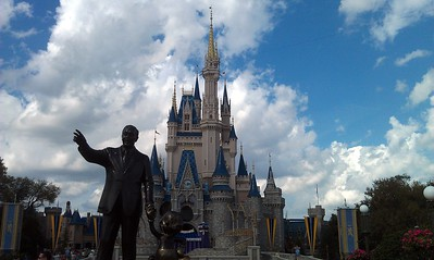 Statue of Walt Disney and Mickey Mouse in front of Cinderella Castle