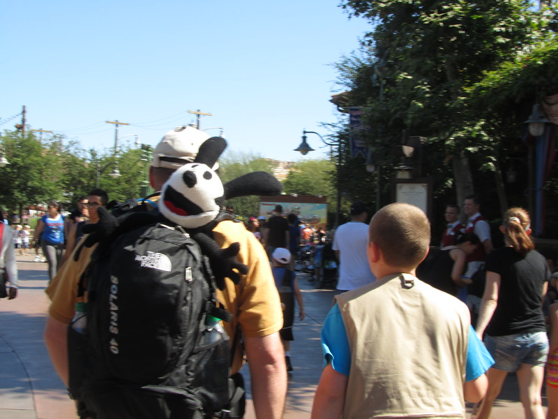 Dad carries Kaara's stuffed Oswald as we walk around the park.