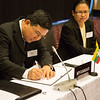 Pwint San, Deputy Minister of Commerce, Myanmar (left), signing the EFTA-Myanmar Joint Declaration on Cooperation; and Naw Mutakapaw, Director, Ministry of Commerce, Myanmar.
