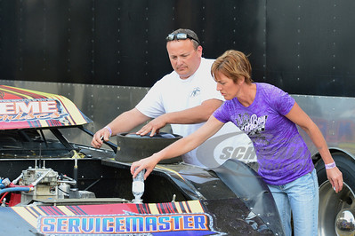 Terry & Lori Casey works on Todd Frank's car