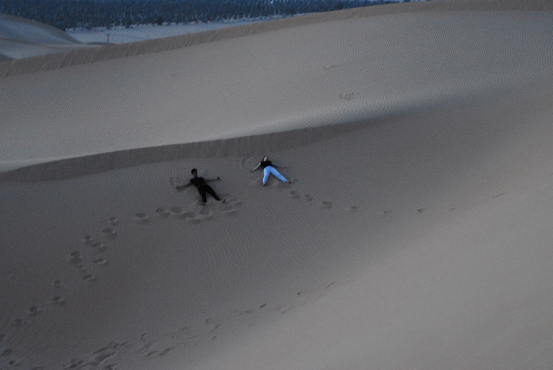 Sand Angels<br /> <br /> Jo Ramirez (L) and Anna Bullard (R) make sand angels in the desert dunes.