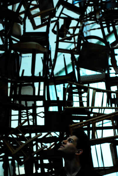 Jo versus the Chairs<br /> <br /> Jo Ramirez takes in the chair installation at the Saadiyat Island Museum.