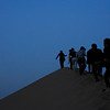 The Edge<br /> <br /> Global Shakespeareans climb the peak of a dune.