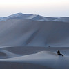 Jo versus the Desert<br /> <br /> Jo Ramirez resting on a dune in the Abu Dhabi desert.