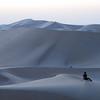 Jo versus the Desert<br /> <br /> Jo Ramirez resting on a dune in the Abu Dhabi desert.