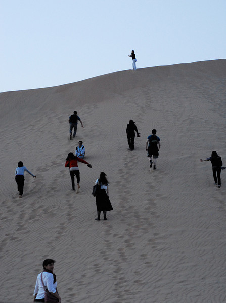 The Climb<br /> <br /> Members of the Global Shakespeare Student Festival climb a dune in the desert.