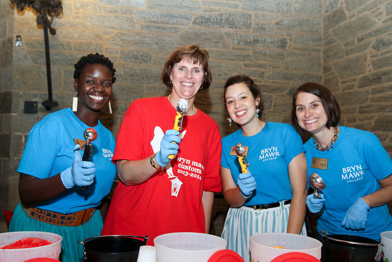 Tiffany Shimate '08, Kim Cassidy, Madeline Birkner, '10, and Jennifer Keegan serving water ice.