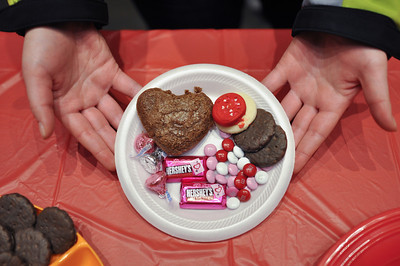 Julie Sliwinski gets a plate of food during the Sisters Ministry Valentine's Banquet February 11, 2013 in Hope Hall.