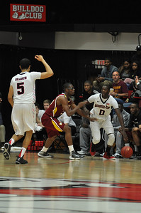 Donta Harper drives towards a pick set by his teammate vs Winthrop University Tuesday February 19, 2013.