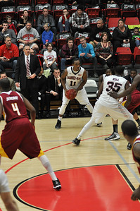 Isaiah Ivey looks for an open pass against Winthrop University Tuesday February 19, 2013.