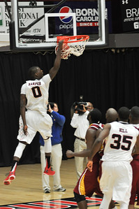 Donta Harper slams a dunk against Winthrop University Tuesday February 19, 2013.