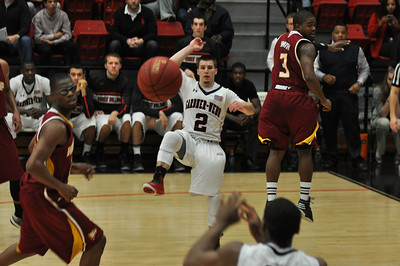Tyler Strange makes a pass across the court against Winthrop University Tuesday February 19, 2013.
