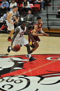 Jarvis Davis drives down the court against Winthrop University Tuesday February 19, 2013.