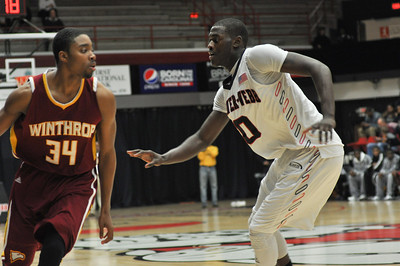 Donta Harper defends against Winthrop University Tuesday February 19, 2013.