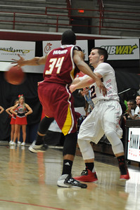 Tyler Strange makes a pass against Winthrop University Tuesday February 19, 2013.