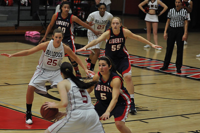 Lana Doran looks to  pass to Tabby Koerner during the game against Liberty University on February 23, 2013.