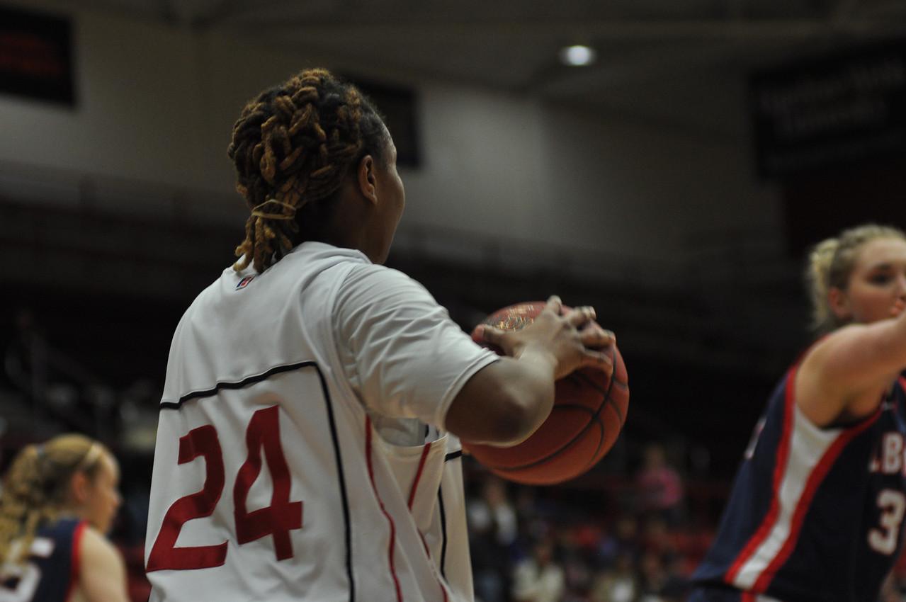 Mayhana Dunovant passes the ball in against Liberty University on February 23, 2013.