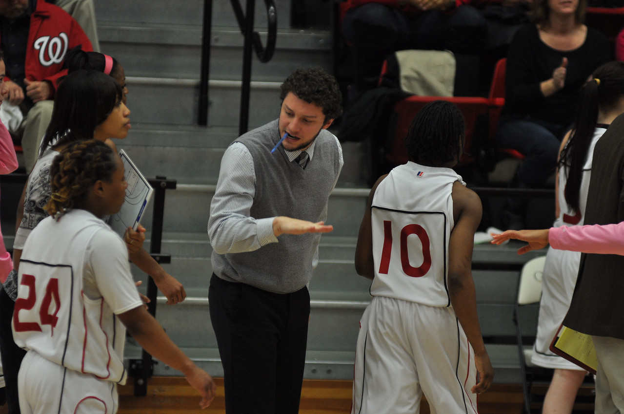 Coach Blake DuDonis congratulates the ladies as they come in for a time-out during the second half against Liberty University on February 23, 2013.