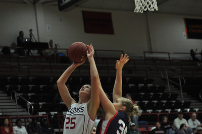 Tabby Koerner shoots against Liberty University on February 23, 2013.