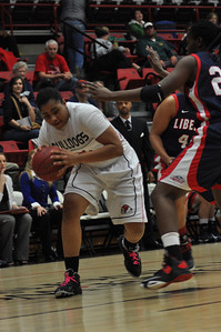 Catrina Green drives to the basket against Liberty University on February 23, 2013.