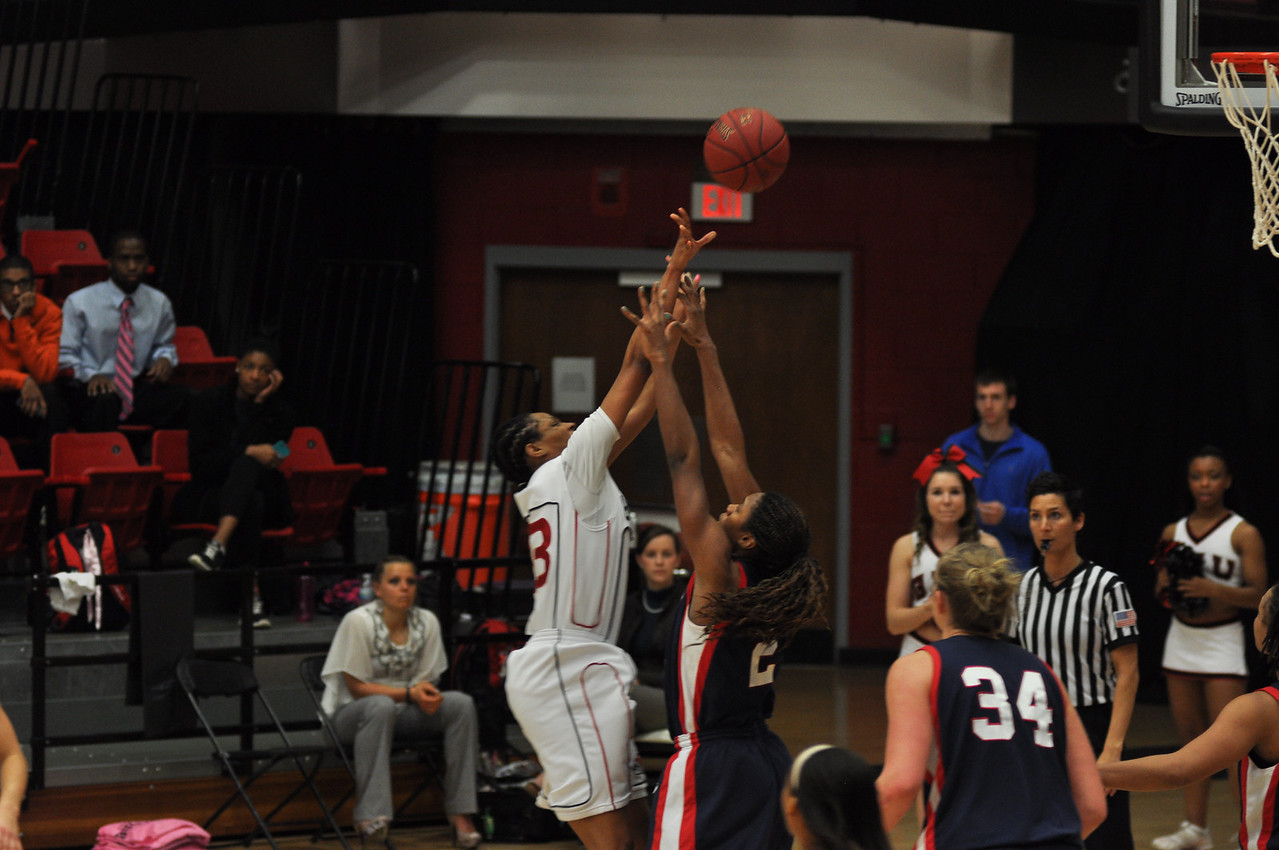 Jessica Heilig shoots down low against Liberty University on February 23, 2013.