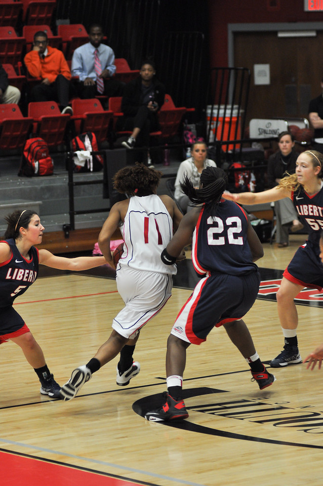 Olivia Parker drives the ball to shoot against Liberty University on February 23, 2013.