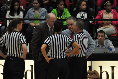The coaches and referees dicuss a questionable call that was made during the game against Liberty University on February 23, 2013.