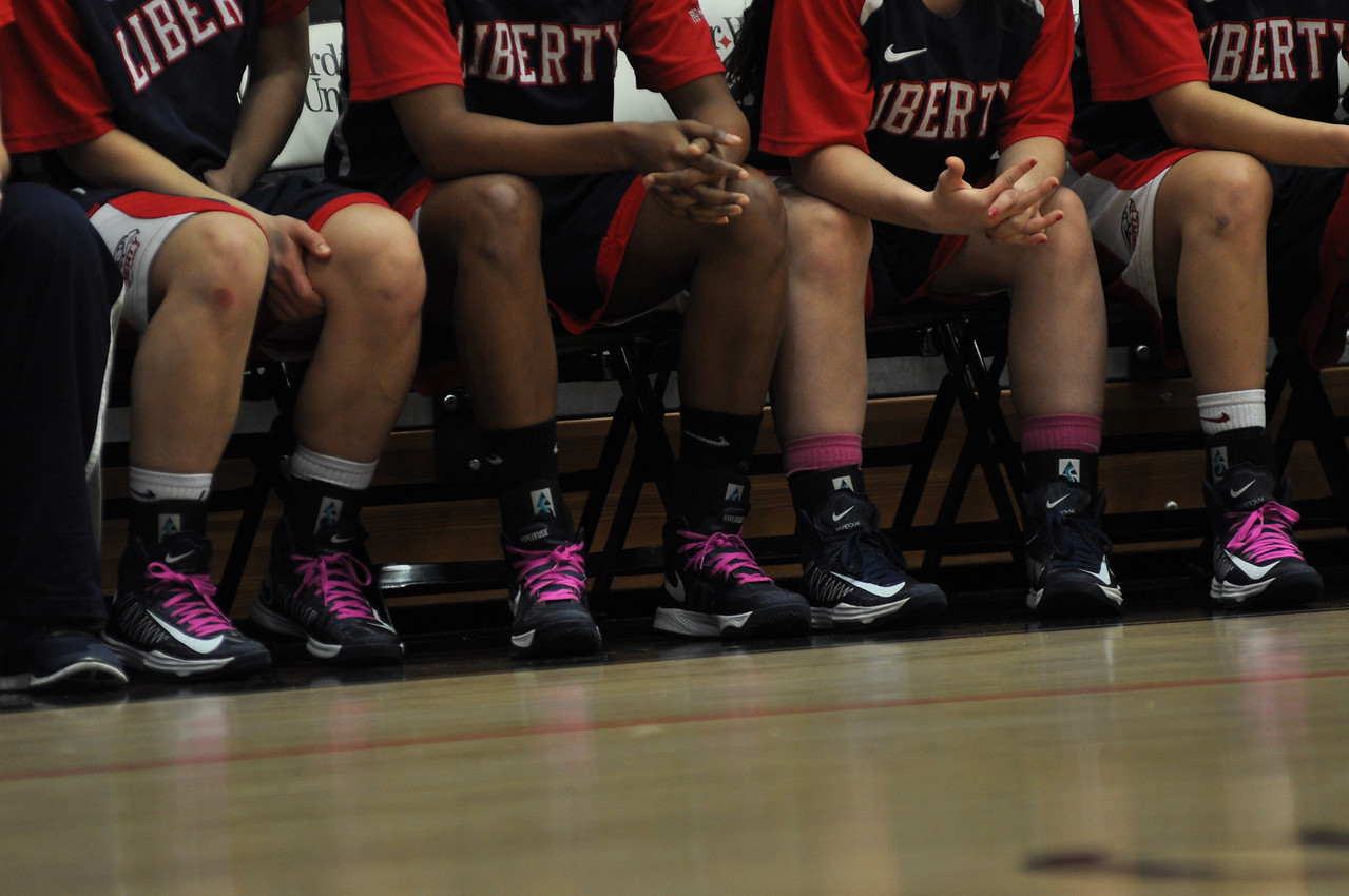 The Liberty Flames wear touches of pink for Breast Cancer Awareness Month.