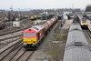21 February 2013 :: 60020 passing through Didcot station in its new DB Schenker colours hauling 6B33 from Theale to Robeston.  Stabled adjacent to the station is network Rail's class 31 No. 31465