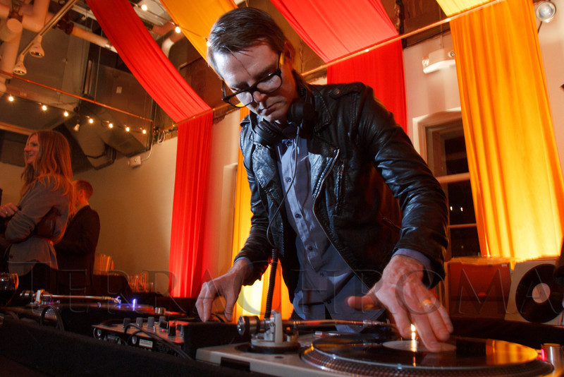 """Matthew Brown (owner of Fancy Tiger Boutique) spins the vinyl.  """"Design After Dark"""" event, themed """"Cirque,"""" benefiting the Denver Art Museum, at the McNichols Civic Center Building in Denver, Colorado, on Friday, Feb. 8, 2013.<br /> Photo Steve Peterson"""