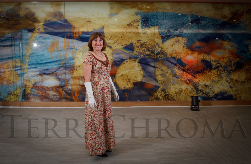"Lynn Heitler in front of her artwork, a mural in the new Emergency Department wing.  ""The Premiere,"" an event hosted by the University of Colorado Hospital Foundation and benefiting the University of Colorado Hospital Emergency Department, at the Department of Emergency Medicine, University of Colorado Hospital, in Aurora, Colorado, on Saturday, Feb. 9, 2013.<br /> Photo Steve Peterson"