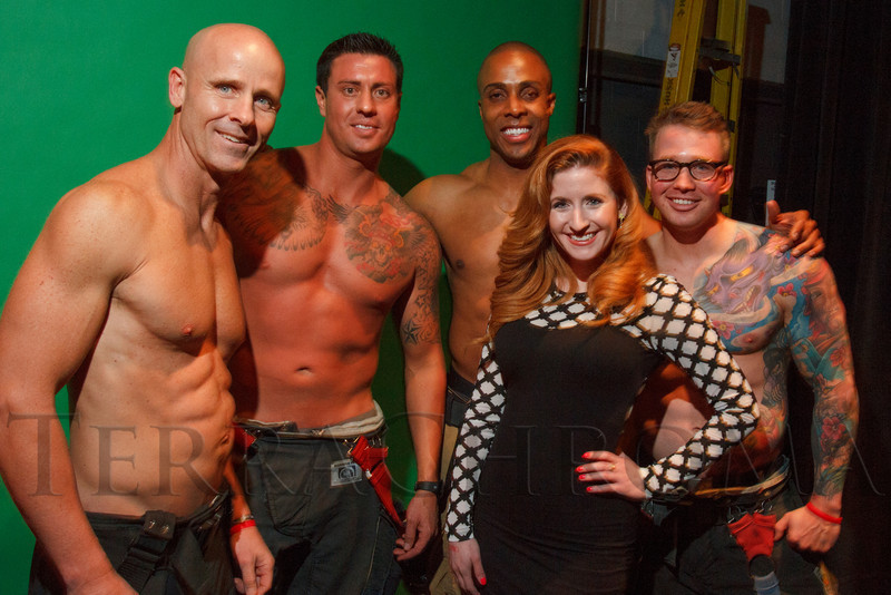 """Rebecca Reynolds with Firefighter Calendar representatives:  Tony Cardenas, Tom Martinez, Anthony Ramsey, and Charlie Keller.  """"Single in the City 2013,"""" presented by 5280 magazine, at Exdo Event Center in Denver, Colorado, on Friday, Feb. 15, 2013.<br /> Photo Steve Peterson"""